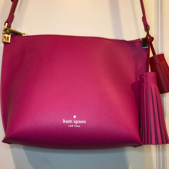 586b010b2 kate spade Handbags - Kate Spade Pink Crossbody with Tassel Detail